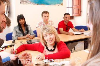 An English teacher delivering a language course in our school in Malta.
