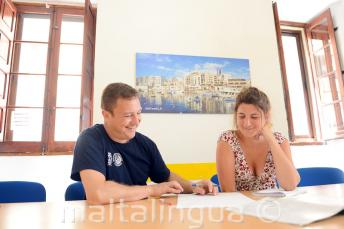 A teacher delivering a private English course at our school in Malta