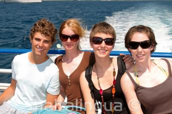 A family enjoying a language school boat trip