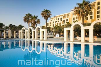 The outdoor swimming pool of the Hilton in St Julians, Malta