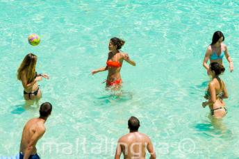 Junior school students playing volleyball at the Blue Lagoon, Malta