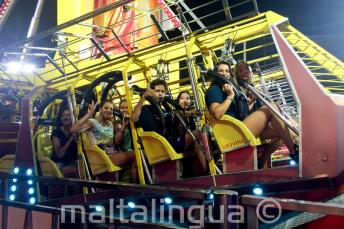 A group of students on a theme park ride