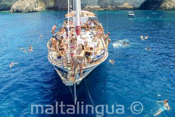 English students on a boat trip in Malta getting ready to jump into the sea