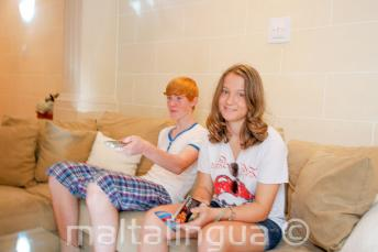 Students sitting on the sofa in host family accommodation