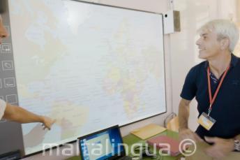 An English language teacher look at a whiteboard