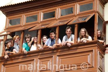 Teen students on a school balcony