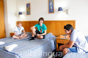 3 teenage students in a room in our school residence