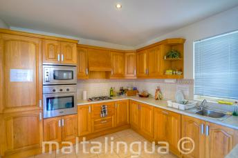 Fully equipped kitchen in a language school shared apartment