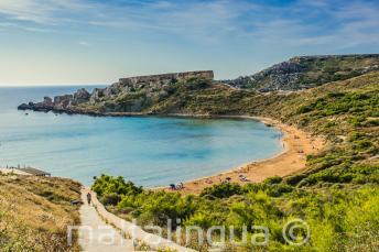 A vista of a sandy beach in Mellieha, Malta