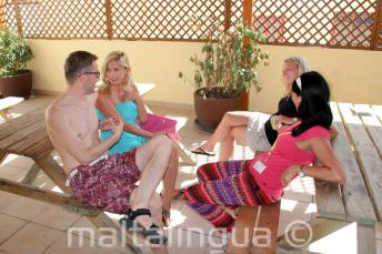 Language students chatting in English