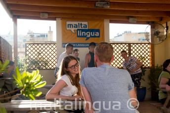 English student talking to her teacher on the terrace