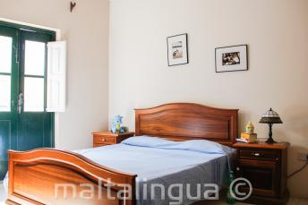 A bedroom in host family accommodation in St Julains