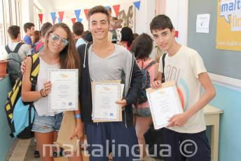 3 students with their course completion certificates