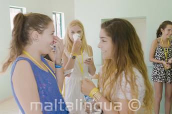 2 English language students chatting at school