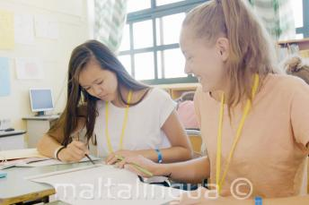 2 girls working together for an English class task