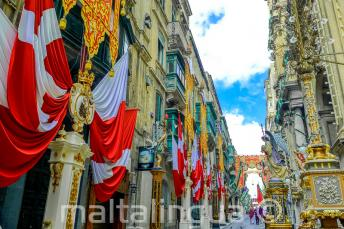 A street in Valletta, Malta decorated with flags