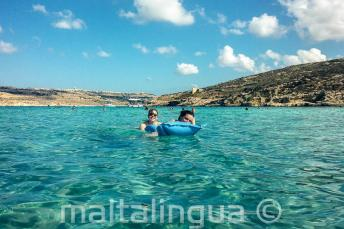 Language school students swimming in the Blue Lagoon at Comino