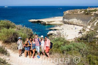 English students visiting St Peter's Pool, Malta