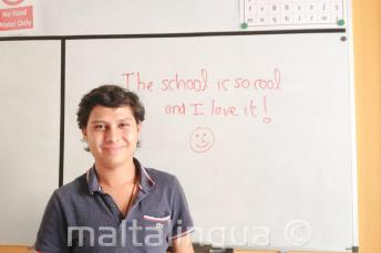 An English student who has written good feedback on the board