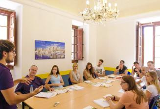 A teacher speaking to a class full of English language students
