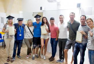 Language school students with course completion certificates