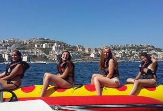 4 girls on a banana boat ride