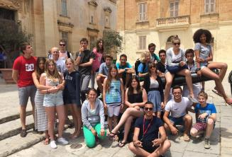 Students sitting on a canon in Mdina