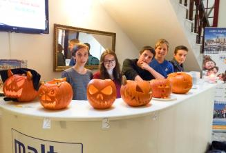 Junior students with carved Halloween pumpkins at the school reception