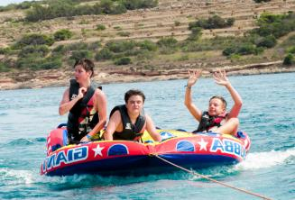 Students on a speed boat sofa ride