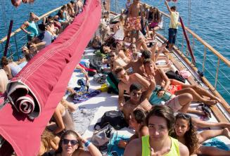 Students sunbathing on the deck of the boat