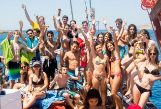 Group of junior language school students on a boat trip