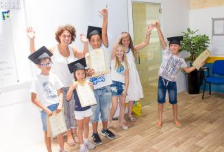Kids with their English language course certificates