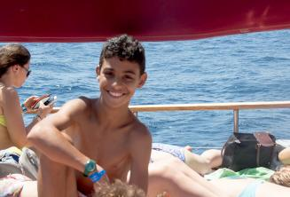 A kids programme student on a school boat trip