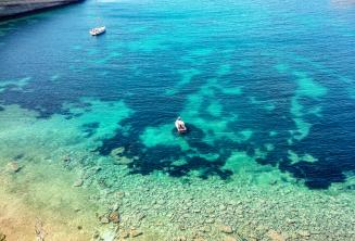 View of a bay in Malta with clear aquamarine water