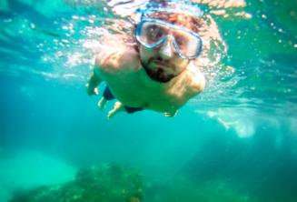 A student snorkelling