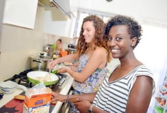 A student helping her host family prepare dinner