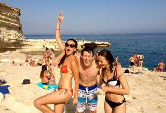 3 teen students on a language school trip to St Peters Pool, Malta