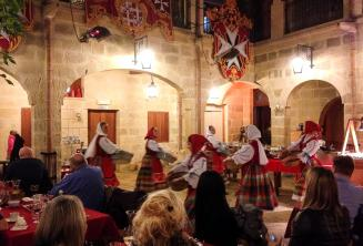 Traditional Maltese dancers putting on a show in a restaurant