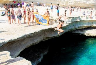 Maltalingua School of English jumping into St Peter's Pool