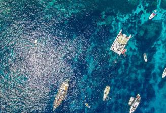Arial photo of boats in Crystal Bay, Comino